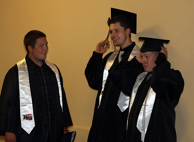 Jeff Krage – For Shaw Media Huntley graduate Nolan Dickte, left, watches as Drew Darlington, center, and Patrick Dodge get ready for Saturday's graduation ceremonies at the Sears Centre in Hoffman Estates. Hoffman Estates 5/31/14