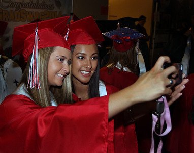 Jeff Krage – For Shaw Media Huntley graduate Sami Jakubowski, left, takes a picture with Jenny Ngo before the start of Saturday's graduation ceremonies at the Sears Centre in Hoffman Estates. Hoffman Estates 5/31/14