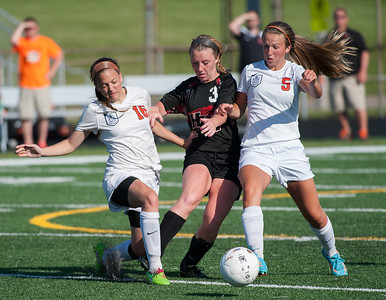 Randy Stukenberg for Shaw Media  Huntley's Jessy Helm (3) tries to push the ball through Harlem's Kirstin Semenchuk (16) and Karley Draheim (5) during the IHSA Class 3A Auburn Sectional Final game Friday, May 30 in Rockford. Huntley won after two overtimes and 2 PK's.     slug: hspts_sat531_gsoc_aub_sec
