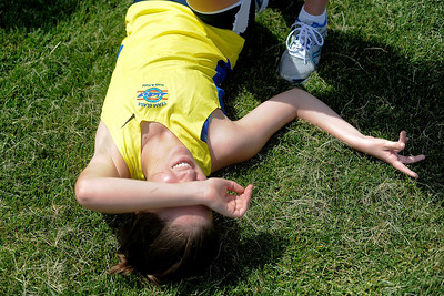 Annie Schlesinger,15, of Naperville,  lays in the grass after competing 1500meter run during ther 7th Run and Roll Track Meet at McKracken field in McHenry.