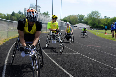 Christan Clemmons, of Waukegan, focuses before the 200m wheelchair race during the 7th annual Run and Roll at McKraken Field in McHenry.