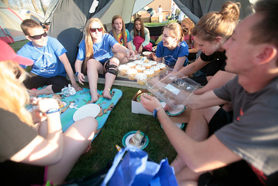 Eighteen-year-old Colin Condon McHenry (far right,) hands cupcakes that he brought for his birthday to his friend 18-year-old Cassadra Diedrich of McHenry as they camp out with fellow National Honor Society members at SleepOut for Shelter in Crystal Lake on Saturday, May 10 2014. The countywide, educational experience and fundraiser looks to help end homelessness in McHenry County with event participants spending the night outside in tents, boxes or cars to raise awareness and money for McHenry County PADS. Michelle LaVigne/ For Shaw Media