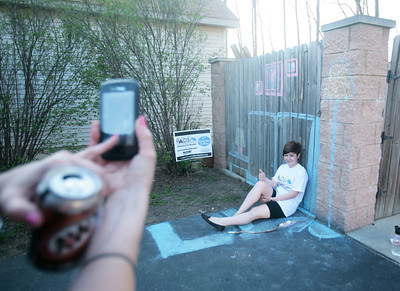 Fifteen-year-old Ahley Starr of Spring Grove poses in a chalk drawing of a living room during the SleepOut Shelter in Crystal Lake on Saturday, May 10 2014. Michelle LaVigne/ For Shaw Media
