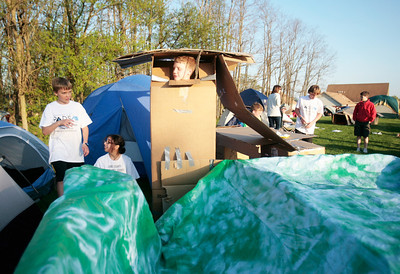 Twelve-year-old Ben Wiese of Crystal Lake calls out from his box tent to friends 12-year-old Madalynn Emberton of McHenry and 12-year-old Liam Gray of Crystal Lake to assist him in getting out. The threesome were participating in SleepOut Shelter, a countywide, educational experience and fundraiser aims to help end homelessness in McHenry County with event participants spending the night outside in tents, boxes or cars to raise awareness and money for McHenry County PADS in Crystal Lake on Saturday, May 10 2014. Michelle LaVigne/ For Shaw Media