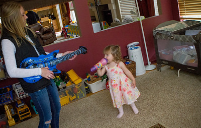 Mike Greene - For Shaw Media  Danielle Bockman, 3, sings while her cousin Alyssa Incapreo, 16 of Hampshire, plays the guitar during a celebration of Bockman's 3rd birthday and the 2-year anniversary of receiving a heart transplant Saturday, May 14, 2016 in Algonquin.