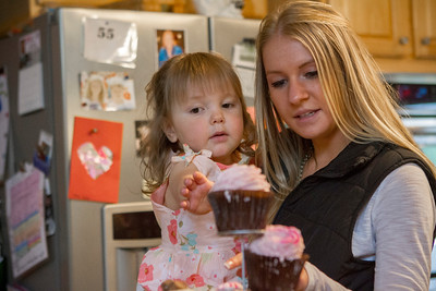 Mike Greene - For Shaw Media  Danielle Bockman, 3, picks out her cupcake with the help of her cousin Alyssa Incapreo, 16 of Hampshire, during a celebration of Bockman's 3rd birthday and the 2-year anniversary of receiving a heart transplant Saturday, May 14, 2016 in Algonquin.