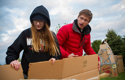 Mike Greene - For Shaw Media  Kieley Medinger, left, 16 of McHenry East High School and Trevor Crippen, 17, work on a shelter during the seventh annual SleepOut for Shelter fundraiser hosted by the Pioneer Center Saturday, May 14, 2016 at The Church of Holy Apostles in McHenry. Event participants spent the night outside in tents, boxes or cars to raise awareness and money for McHenry County PADS.