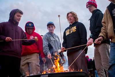 Mike Greene - For Shaw Media  Event participants gather around a fire pit to make S'mores during the seventh annual SleepOut for Shelter fundraiser hosted by the Pioneer Center Saturday, May 14, 2016 at The Church of Holy Apostles in McHenry. Event participants spent the night outside in tents, boxes or cars to raise awareness and money for McHenry County PADS.