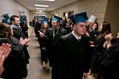 Michelle LaVigne/ For Shaw Media The graduating seniors of Woodstock North High School walk through the line of faculty and staff as they head into the gymnasium for their graduation ceremony.