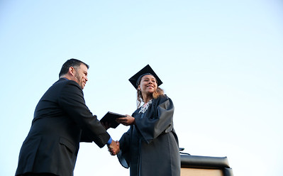 Michelle LaVigne/ For Shaw Media Destiny Chacon receives her diploma during the McHenry East's High School Graduation ceremony