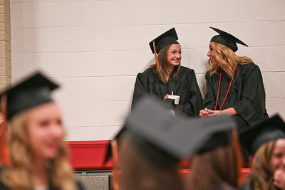 Michelle LaVigne/ For Shaw Media Zosia Wilczynski (left,) and Jordan Frank of McHenry chat before lining up for for McHenry East's High School Graduation ceremony.
