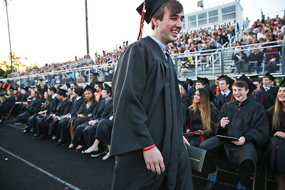 Michelle LaVigne/ For Shaw Media Hunter Faith exits the stage after receiving his diploma at McHenry East's High School Graduation ceremony.