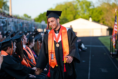 Michelle LaVigne/ For Shaw Media Class president Ivan DeJesus returns to his seat after addressing the class during McHenry East's High School Graduation ceremony.