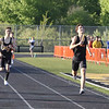 St. Charles East's JB Sandlund runs anchor for his 4x800 relay race team during the 3A sectional at Metea Valley High School in Aurora May 19.