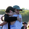 Geneva's Josh Rodgers hugs his father Doug Rodgers after taking first place in the 3200 meter run during the 3A sectional track and field meet at Metea Valley High School in Aurora May 19.