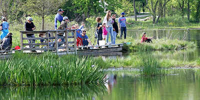 Candace H. Johnson Children and their families fish together during the Lindenhurst Park District's annual Carp Fishing Derby at John Jenega Memorial Park in Lindenhurst.