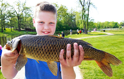 Candace H. Johnson Eli Welch, 10, of Antioch holds up a carp he caught during the Lindenhurst Park District's annual Carp Fishing Derby at John Jenega Memorial Park in Lindenhurst.