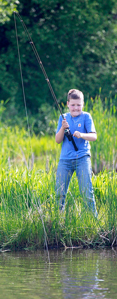 Candace H. Johnson Eli Welch, 10, of Antioch reels in a carp during the Lindenhurst Park District's annual Carp Fishing Derby at John Jenega Memorial Park in Lindenhurst.