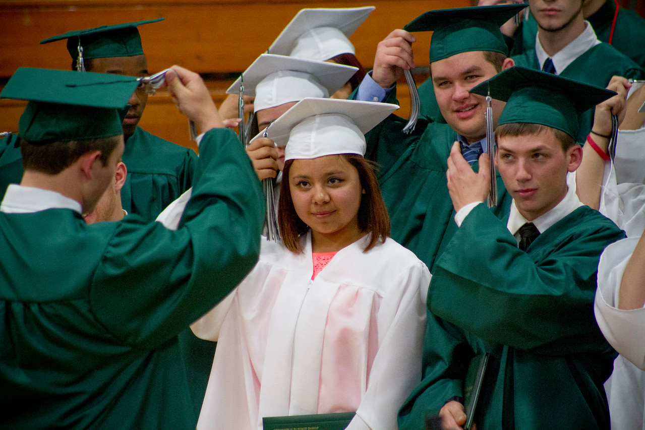 Mike Greene - For Shaw Media  Jasmine Gorostieta Hernandez and Nicholas Cichy moves their tassles to the side during graduation ceremonies for Alden Hebron High School Sunday, May 22, 2016 in Hebron.