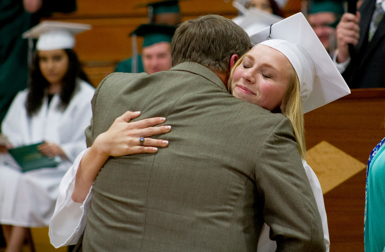 Mike Greene - For Shaw Media  Zoee Lagerhausen receives a hug while getting her diploma during graduation ceremonies for Alden Hebron High School Sunday, May 22, 2016 in Hebron.