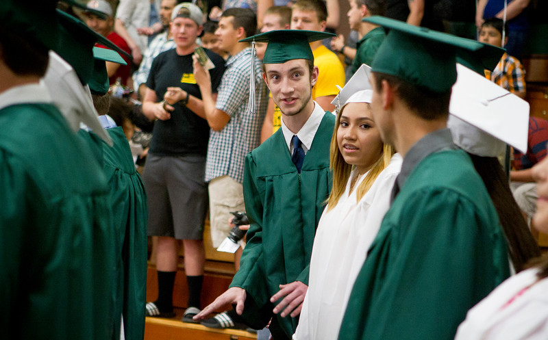 Mike Greene - For Shaw Media  Bradley Cracker talks with classmates during graduation ceremonies for Alden Hebron High School Sunday, May 22, 2016 in Hebron.