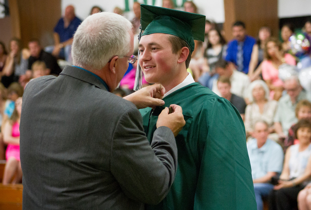Mike Greene - For Shaw Media  Valedictorian Trevor Redlin receives an award during graduation ceremonies for Alden Hebron High School Sunday, May 22, 2016 in Hebron.
