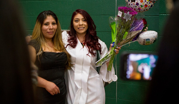 Mike Greene - For Shaw Media  Calorina Mendez, right, poses for a photo with her mother Maria following graduation ceremonies for Alden Hebron High School Sunday, May 22, 2016 in Hebron.