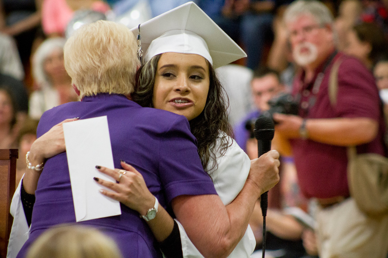 Mike Greene - For Shaw Media  Evelyn Gonzalez Hernandez receives a hug while getting an award during graduation ceremonies for Alden Hebron High School Sunday, May 22, 2016 in Hebron.