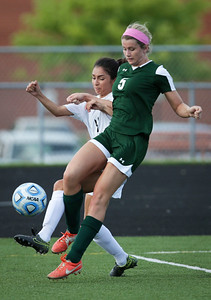 Brandie Minogue (5) from Crystal Lake South gets a foot on the ball in front of Adela Pelayo (4) from Harlem during the first half of their Streamwood Class 3A Girls Soccer Sectional on Thursday, May 26, 2016 in Streamwood, Illinois. The Gators won the game 2-0.  John Konstantaras photo for the Northwest Herald