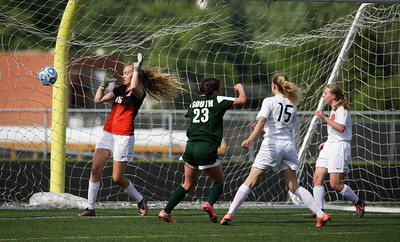 Samantha Sisto (23) from Crystal Lake South scores a goal on Madison Vicencio (16) from Harlem during the first half of their Streamwood Class 3A Girls Soccer Sectional on Thursday, May 26, 2016 in Streamwood, Illinois. The Gators won the game 2-0.  John Konstantaras photo for the Northwest Herald