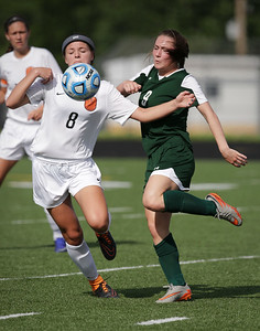 Courtney Sengstock (9) from Crystal Lake South and Delaney Anderson (8) from Harlem battle for a ball during the first half of their Streamwood Class 3A Girls Soccer Sectional on Thursday, May 26, 2016 in Streamwood, Illinois. The Gators won the game 2-0.  John Konstantaras photo for the Northwest Herald