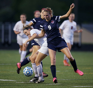 Taryn Jakubowski (11) of Huntley gets tangled up with Alena Ignatev (9) of South Elgin as they chase a ball during the second half of the Streamwood Class 3A Girls Soccer Sectional on Thursday, May 26, 2016 in Streamwood, Illinois. The Red Raiders defeated the Storm 2-1.  John Konstantaras photo for the Northwest Herald