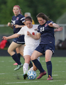 Brianna Wilder (left) of Huntley and Gabriela Danesi (23) of South Elgin battle for a ball during the first half of the Streamwood Class 3A Girls Soccer Sectional on Thursday, May 26, 2016 in Streamwood, Illinois. The Red Raiders defeated the Storm 2-1.  John Konstantaras photo for the Northwest Herald