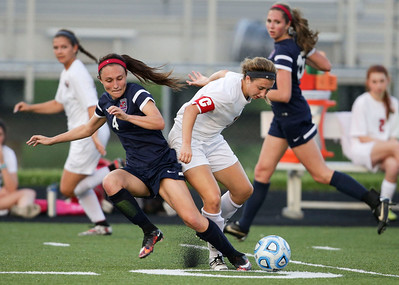 Taryn Jakubowski (right) of Huntley moves the ball around Arielle Walters (4) of South Elgin during the second half of the Streamwood Class 3A Girls Soccer Sectional on Thursday, May 26, 2016 in Streamwood, Illinois. The Red Raiders defeated the Storm 2-1.  John Konstantaras photo for the Northwest Herald