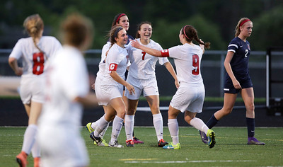 Taryn Jakubowski (left) of Huntley celebrates her game winning goal with her teammates during the second half of their Streamwood Class 3A Girls Soccer Sectional against South Elgin on Thursday, May 26, 2016 in Streamwood, Illinois. The Red Raiders defeated the Storm 2-1.  John Konstantaras photo for the Northwest Herald