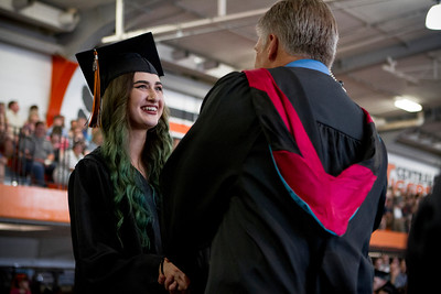 Mike Greene - For Shaw Media  Jessica Fujiyama receives her diploma during graduation ceremonies for Crystal Lake Central Saturday, May 28, 2016 in Crystal Lake.