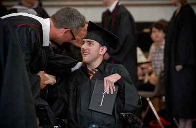 Mike Greene - For Shaw Media  Asa Pittner shakes hands with Crystal Lake Central principal Steven Olson after receiving his diploma during graduation ceremonies for Saturday, May 28, 2016 in Crystal Lake.