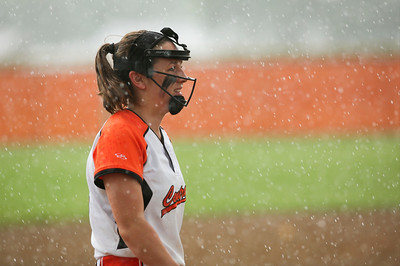 Clare Urbanski (4) of Crystal Lake Central stands in the rain during warm ups for their Class 4A McHenry Regional final against Prairie Ridge at McHenry High School West on Friday, May 27, 2016 in McHenry. The game was rescheduled to Saturday at 2pm because of the rain.  John Konstantaras photo for the Northwest Herald