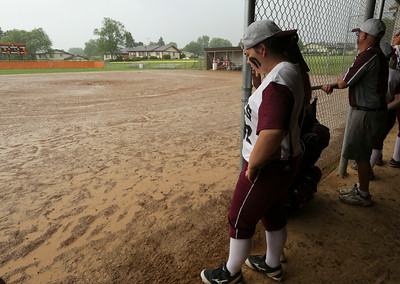 Kaitlin Leverenz (42) of Prairie Ridge looks out at the field after a downpour  before their Class 4A McHenry Regional final against Crystal Lake Central on Friday, May 27, 2016 in McHenry. The game was moved to Saturday at 2pm.  John Konstantaras photo for the Northwest Herald