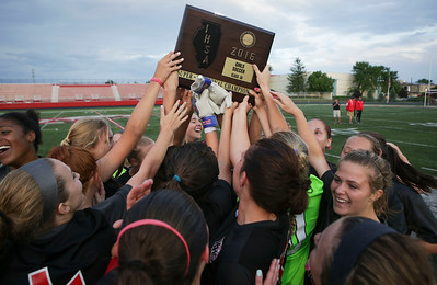 Huntley players hold up their after their Barrington Supersectional championship plaque after beating Barrington 1-0 on Tuesday, May 31, 2016 in Barrington.   John Konstantaras photo for the Northwest Herald