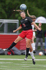 Taryn Jakubowski (11) of Huntley heads a ball in front of Kayla Keck (14) of Barrington during the first half of their Barrington Supersectional game on Tuesday, May 31, 2016 in Barrington. The Red Raiders won the game 1-0.  John Konstantaras photo for the Northwest Herald
