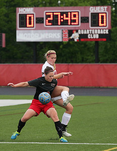 Brianna Wilder (9) of Huntley keeps the ball away from Haley Tausend (18) of Barrington during the first half of their Barrington Supersectional game on Tuesday, May 31, 2016 in Barrington. The Red Raiders won the game 1-0.  John Konstantaras photo for the Northwest Herald