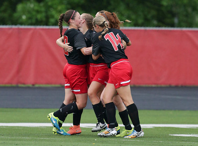 Huntley players celebrate the game winning goal by Taryn Jakubowski (11) during the first half of their Supersectional game against Barrington on Tuesday, May 31, 2016 in Barrington. The Red Raiders won the game 1-0.  John Konstantaras photo for the Northwest Herald