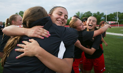 Taryn Jakubowski (left facing) of Huntley gets a hug after the defeated Barrington in their Supersectional game on Tuesday, May 31, 2016 in Barrington. The Red Raiders won the game 1-0.  John Konstantaras photo for the Northwest Herald