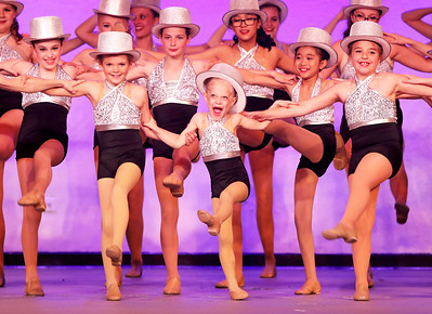 "Candace H. Johnson Mackenzie Speer, 7, of Mundelein (center) dances with the Mundelein Dance Company in the finale to the song called, ""Broadway Bound,"" during the Mundelein's Got Talent dance recital presented by the Mundelein Park District at Mundelein High School."