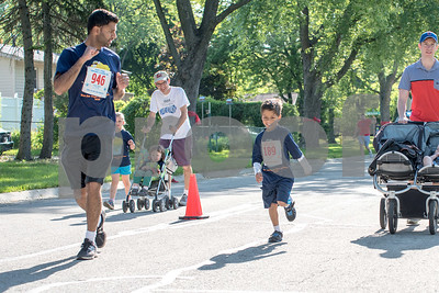 A father and son race to the finish of the kids 1 mile race as part of the Cupcake Classic 5k run in Downers Grove on Sunday, May 22nd. Lorae Mundt for Shaw Media