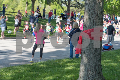 The Cupcake Classic 5k kicks off Downers Grove on Sunday, May 22nd to help raise money for Batten disease. Red ribbons tied around trees in town honor  Noah VanHoutan, who recently died of Batten disease. Lorae Mundt for Shaw Media