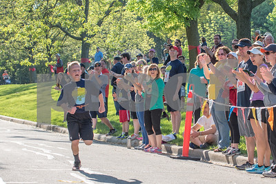 The crowd cheers as runners pass during the Cupcake Classic 5k run in Downers Grove on Sunday, May 22nd. Lorae Mundt for Shaw Media