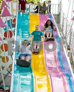 Kids slide down a fun slide Saturday during the Taste of Glen Ellyn. David Toney for Shaw Media