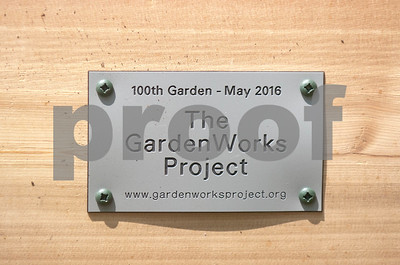 A plaque showing off the Garden Works Project and commemorating the 100th garden project. David Toney for Shaw Media